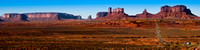 A 4:1 panoramic image of the highway leading to Monument Valley in Utah.