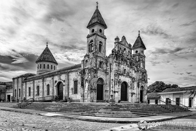 A black and white photograph of a historic church in Granada, Nicaragua.