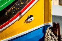 A close-up shot of a fishing boat at Xlendi Bay on Gozo Island in Malta.